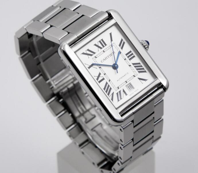 The blue hands are contrasted to the silver dial.